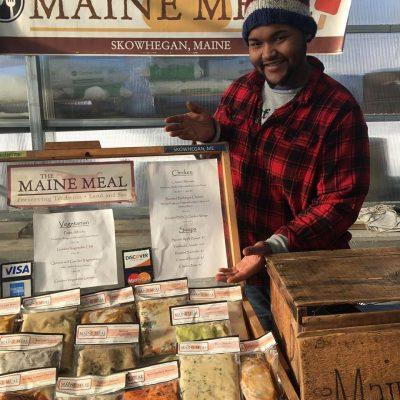 Tony selling display at market